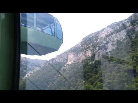 Going up Mount Parnes, in Athens Greece, in a cable car