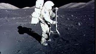 Apollo 17 Harrison Hagan Jack Schmitt trying to kick a rock down hill on the moon 1972