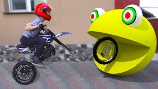 Kid Biker Rides on Motorcycle Power Wheels | Damian Pretends Play with Funny PAC MAN
