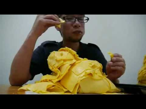 Guy Eats Burger With 1,000 Slices Of Cheese