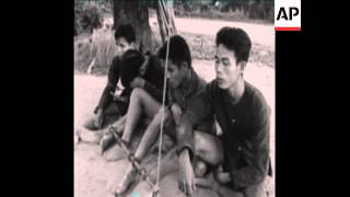 CAN377 VIETNAMESE SOLDIERS INTERROGATE CAPTURED VIET CONG