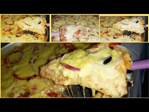 صورة  طريقة عمل البيتزا اسرار عمل البيتزا المشكل جبن وطريقة البيتزا التونةوالعجينة هشة وطرية طريقة عمل البيتزا من يوتيوب