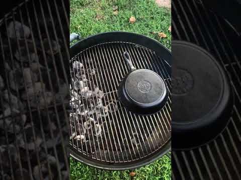 Seasoning Cast Iron Skillet on a Weber Kettle Grill.