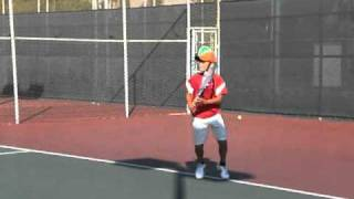 Rafael Nadal watching while Murphy Jensen drills Perry Gregg age 10 on backhands