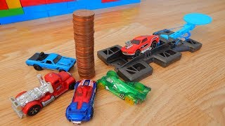 A TOWER OF 56 COINS SHOT DOWN BY CARS SLOW MOTION RECORD