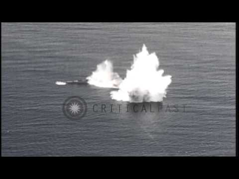 A Japanese submarine explodes and sinks leaving behind an oil slick after being h...HD Stock Footage