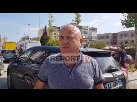 Report Tv - Përplasje para gjykatës në Vlorë mes 10 personave për guroren, 2 të lënduar