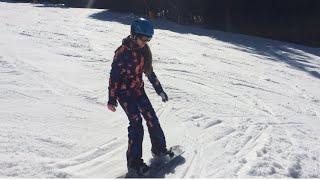 Научились на сноуборде