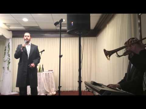 Shloime Gertner sings at a Chuppah