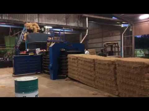 Automatic palm fiber baling machine