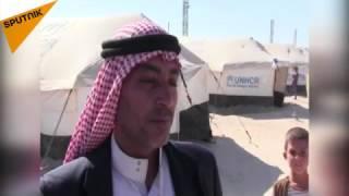 بالفيديو.. آلاف العراقيين يهربون إلى سوريا خوفًا من تنظيم «داعش»