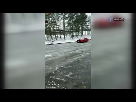 Icy Texas road causes 18 wheeler to crash into traffic ligh