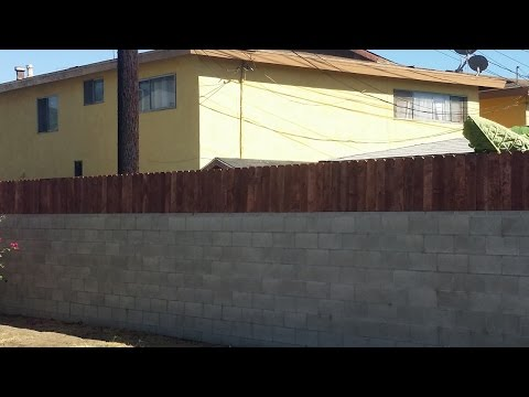 Build a privacy fence on top of a block wall