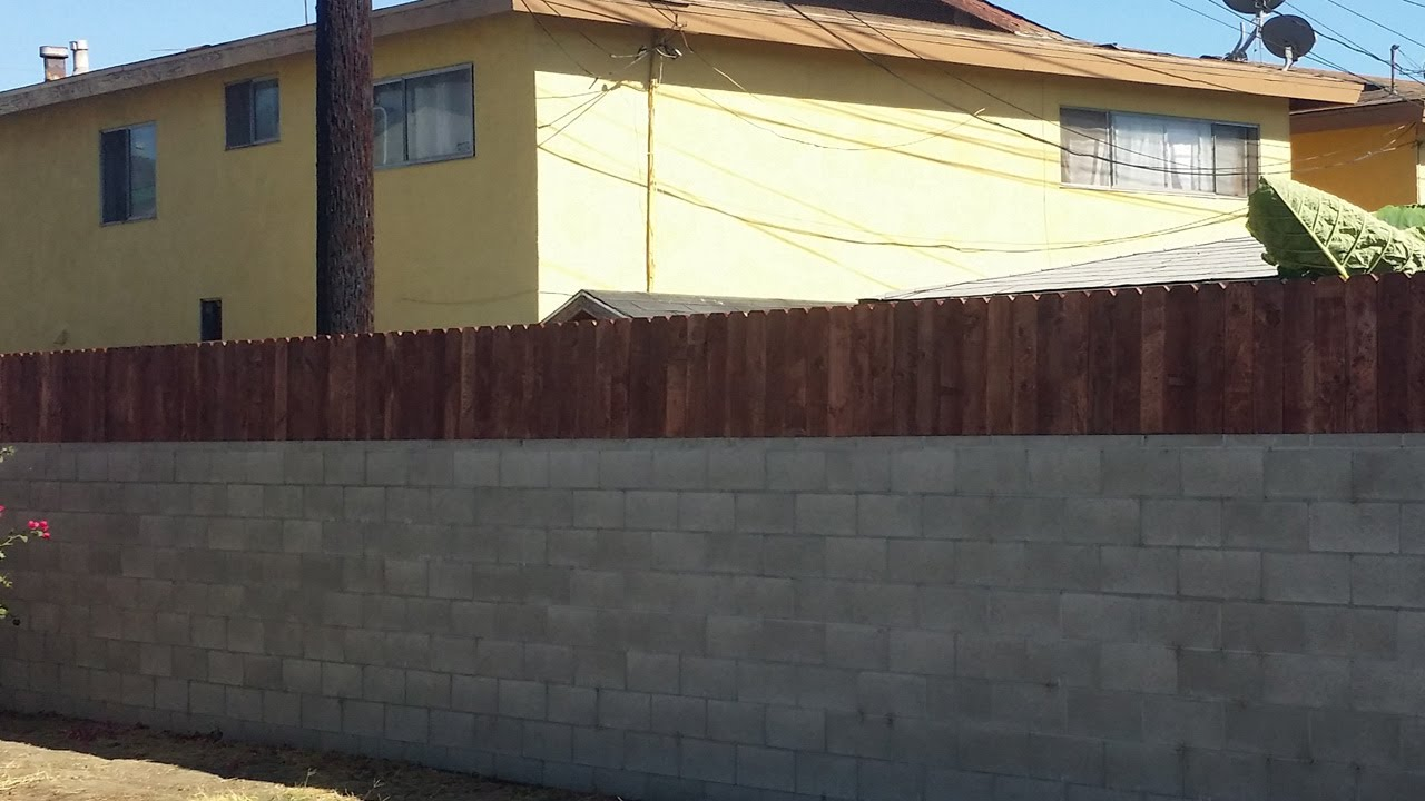 Build a privacy fence on top of a block wall - YouTube