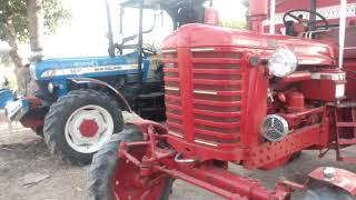 NEW HOLLAND 5630 PLUS 4X4  AND  BAILARAS  1976