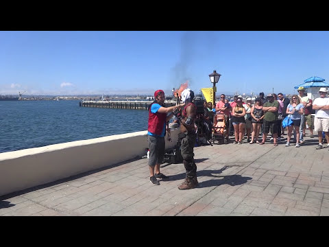 Weirdo interupts performer at Seaport Village Buskers Festival 2015 and makes a dollar