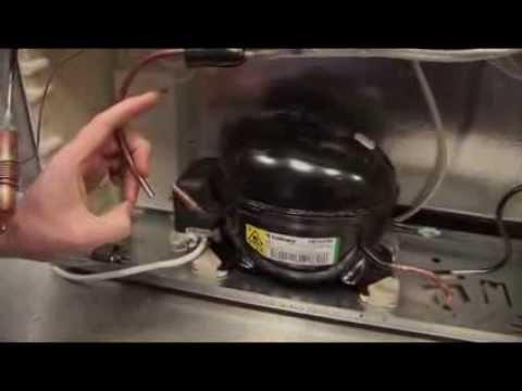 Ремонт холодильника - установка муфт Локринга с помощью клещей .