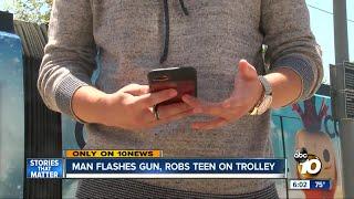 Man flashes gun, robs teen on trolley