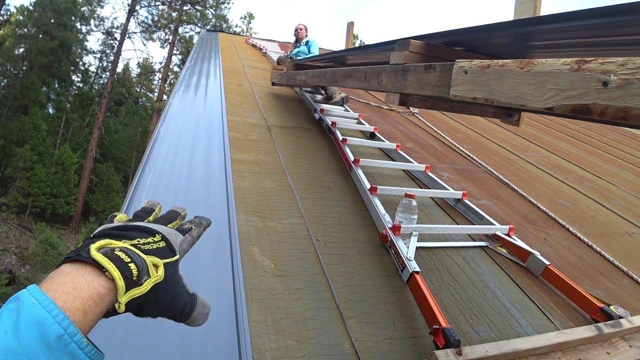 first-panel-boom-hidden-hardware-metal-roof-install