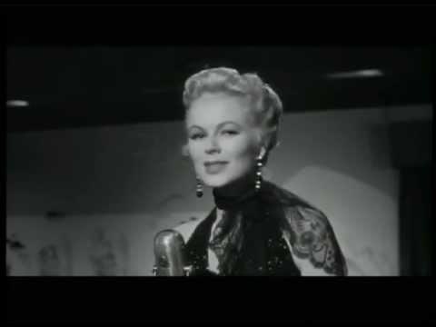 Barbara Hale sings in The Houston Story 1956