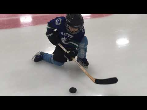 Young Children Learning to Play Ice Hockey
