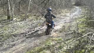 kid dirt bike in mud