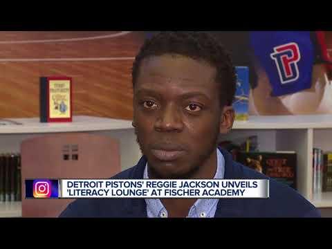 Detroit Piston's Reggie Jackson unveils Literacy Lounge at Fischer Academy.