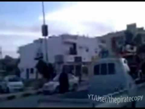 Libyan loyalist shoots NATO al-Qaeda rebel, flying flag in Tripoli.