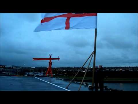HMS Ark Royal lowering the White Ensign for the last time on the River Tyne,22.11.2010.