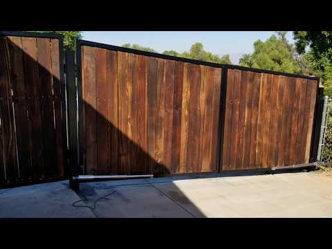 wrought  iron gate project electric gate opener on slopped driveway