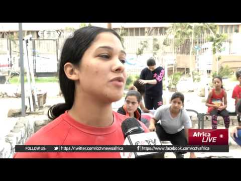 Women in Alexandria defy challenges to excel in weightlifting