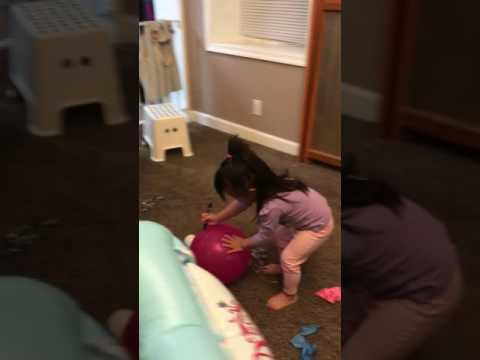 Funny baby popping balloons