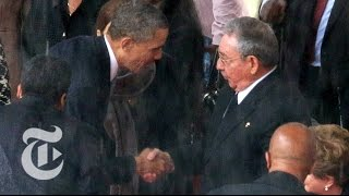 Obama Shakes Hands With Raúl Castro at Mandela