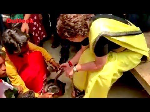 Priyanka Gandhi Holds A Snake While Campaigning in Rae Bareli