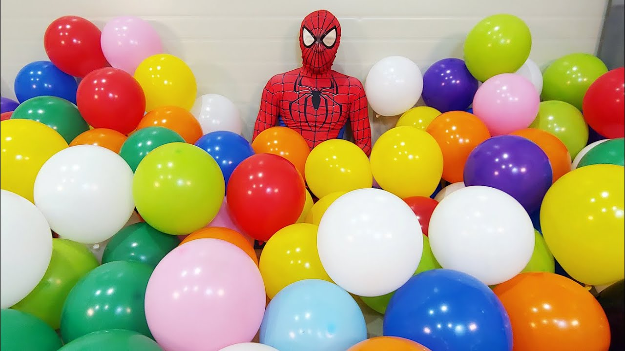 Spider Man Popping Balloons & Trick Shots!