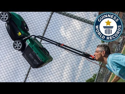 Farthest distance walked balancing a lawnmower on the chin (powered) – Guinness World Records