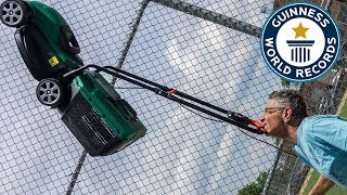 Farthest distance walked balancing a lawnmower on the chin (powered) - Guinness World Records