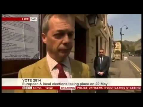 man makes wanker sign behind nigel farage live on bbc news