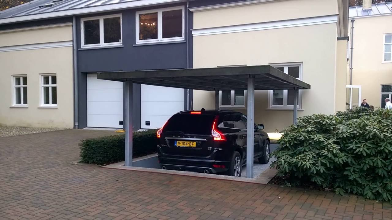 Flexitec ruimtebesparende autolift youtube for Garage souterrain ascenseur