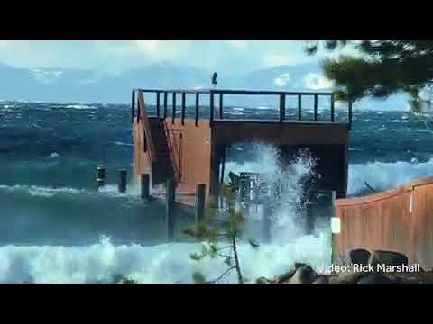 Large waves in Lake Tahoe crash on to beach
