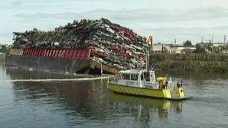 Barge carrying crushed cars sinks in Canada