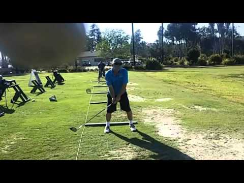 Swinging driver at Oceanside municipal golf course