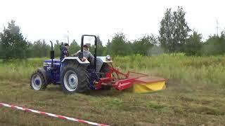 Koszenie traw ciągnikiem z kosiarką rotacyjną - maszyny rolnicze i komunalne ZapleczeFarmera.pl