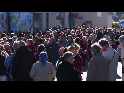 Ukrainian elderly people queue for food aid from Russia