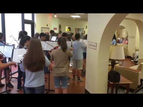 Alexa and the Arvida Middle School Orchestra visit senior citizens