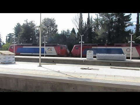Greece: A pair of TrainOSE Class 220 diesel locos leave Leianokladi on a Thessaloniki - Athens train