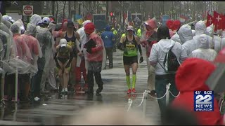Runners brave freezing rain and strong winds at Boston Marathon