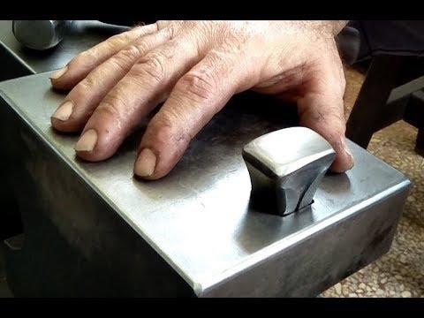 hand forging a blacksmith anvil hardy tool