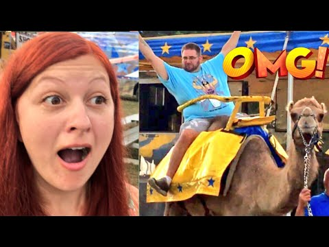 ELEPHANT RIDES A CAMEL! EMBARRASSING HUSBAND ACTS CRINGEY AT COUNTY FAIR