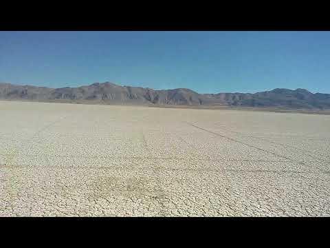 Ben land sailing solid wing carbon fiber machine at Black Rock City playa